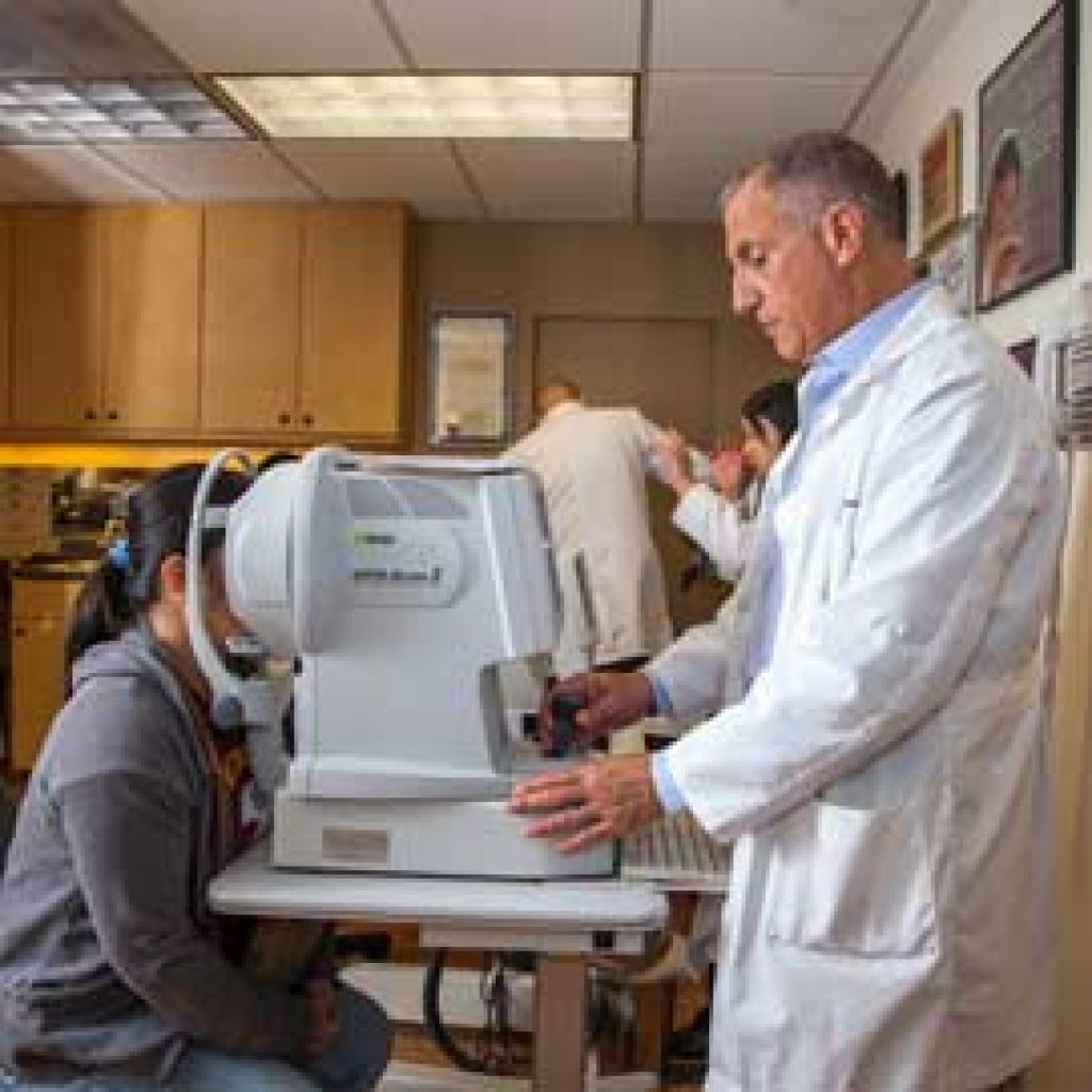 Dr. Leonard performs an eye exam for an SFV resident.