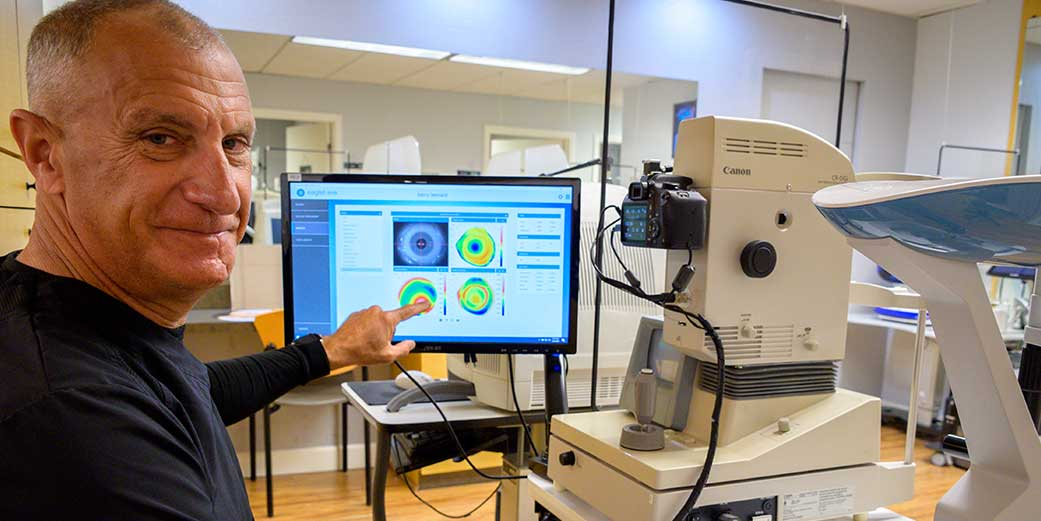 Dr. Leonard with data from an Eaglet Eye Surface Profiler scan of a patient with Keratoconus